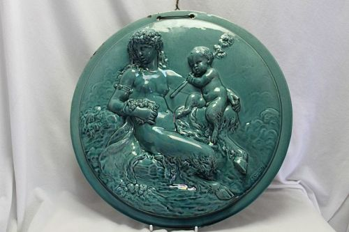 Glazed pottery wall plaque after Clodion