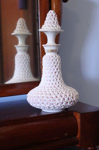 Flower encrusted porcelain scent bottle