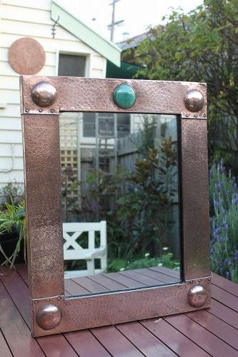 Arts and Crafts beaten copper framed mirror