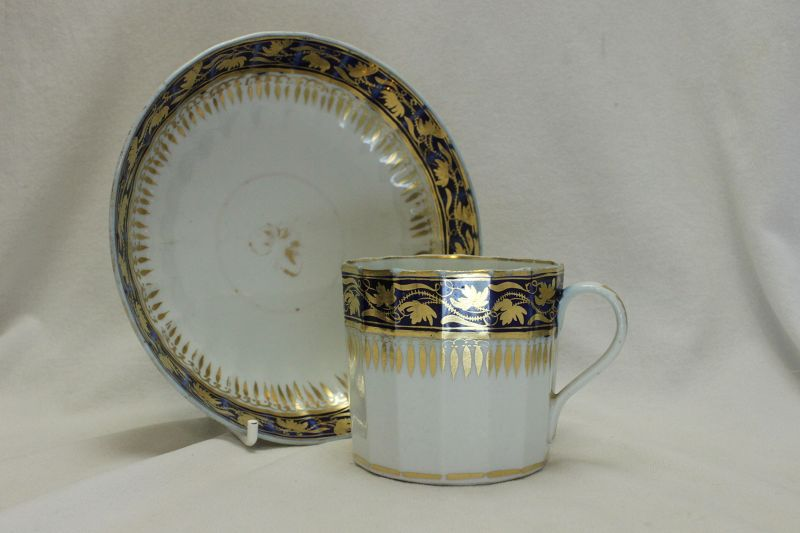 Blue and gilt decorated coffee can and saucer possibly Coalport