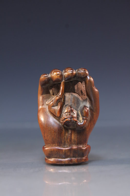 Japanese Carved Rosewood Netsuke Figure. Hand & Monkey.
