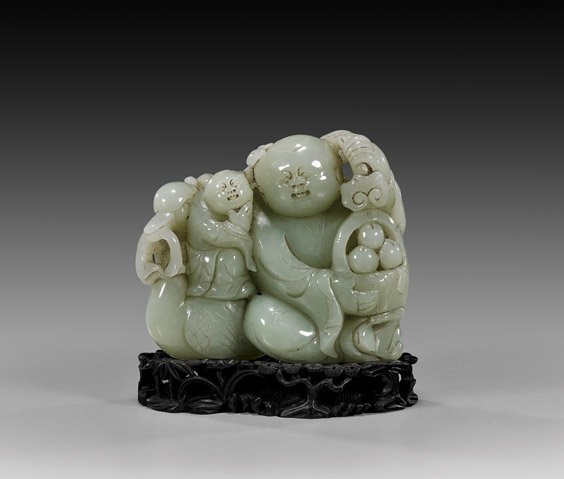 Chinese Carved Celadon Jade Figural Group.