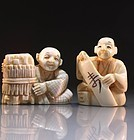 Two Japanese Carved Ivory Figural Netsukes.