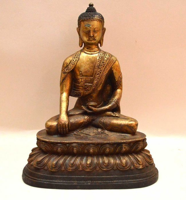 Antique Sino-Tibetan Gilded Cast Figure of Buddha.