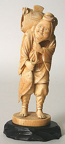 Japanese carved ivory okimono of a peddler with fish
