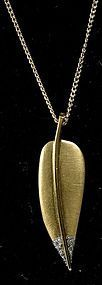 Tiffany & Co. Angela Cummings 18K, plat & diamonds leaf pendant
