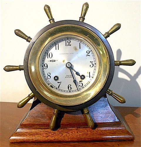 Chelsea Ship's Bell clock on mahogany stand