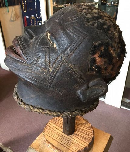 African carved helmet mask of a human head - Makonde