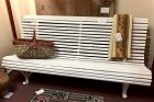 Vintage curved wood slat garden bench