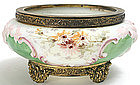 Wave Crest bowl in ormolu frame, signed, rare colors