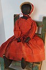 Antique black cloth doll in red polka dot dress18""