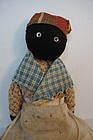 Early black cloth stump doll  brown calico dress
