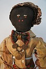 Antique black boy doll with fabulous original clothes