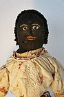 Large antique black cloth doll embroidered face layers of clothes
