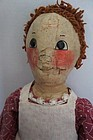 A large happy antique painted face doll big button eyes rosy cheeks
