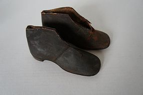 Early antique pair of hand made shoes with wooden form 1830