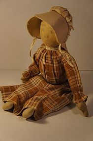 Pencil face prairie type cloth doll brown dress  tan bonnet antique