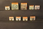 A collection of 9 antique Putz wooden toy houses