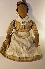 Antique embroidered face black cloth doll