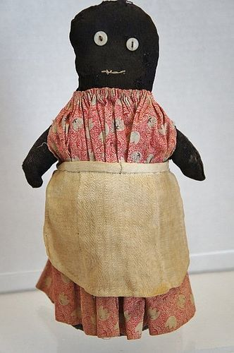 a plain and simple small black bottle doll door stop
