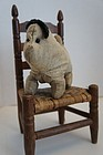 Antique Amish type flannel dog with worried look 19th C.