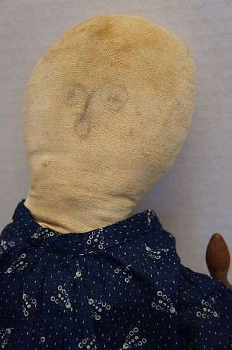 Pencil face antique cloth doll with blue calico dress.