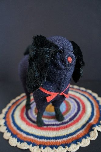 Antique spaniel dog with fur ears and red collar.