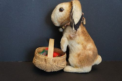 "10"" Steiff mohair rabbit with lots of bells around her neck."