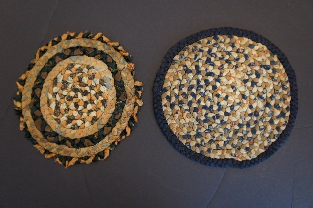 """Two braided antique candle stick mats 19th C.  5"""" and 6"""" dia."""