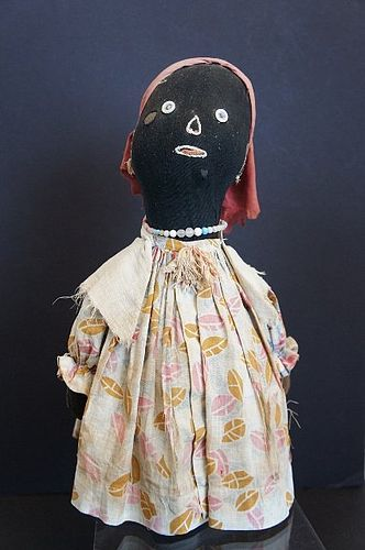 A great black bottle doll doorstop original clothes antique folk art