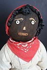 Black cloth bottle doll with great embroidered face and clothes