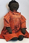 Antique black stockinette embroidered face cloth doll red calico dress