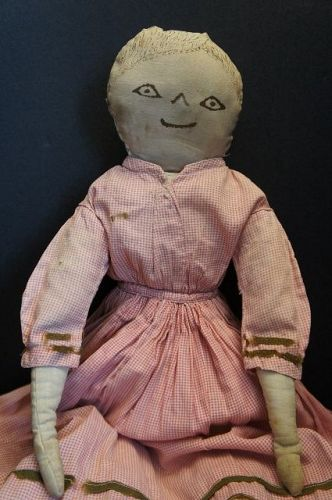 Antique cloth doll with sepia ink drawn face great early dress