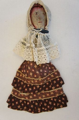 Small loveable stump doll with homemade clothes simple and sweet