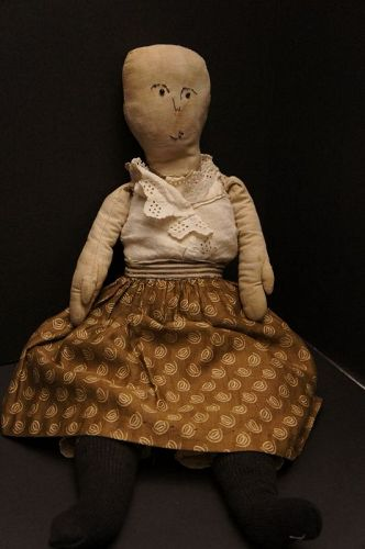 A real charactrer rag doll with quirky stitched face big mitten hands