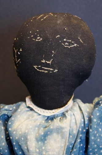 "A special black cloth doll with embroidered face 21"" antique"