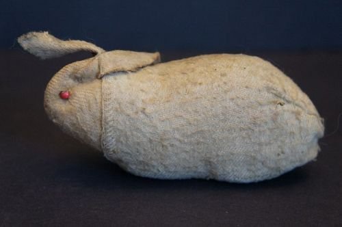 A Pennsylvania antique flannel bunny rabbit with a rattle
