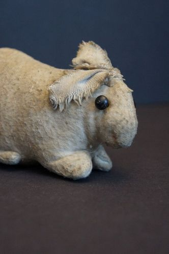 An antique flannel rabbit with shoe button eyes from Ohio