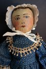 Painted face antique doll in blue calico dress prim and proper 19""