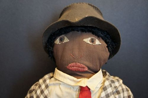 "All original black cloth man doll with suit and tie 19"" circa 1920"