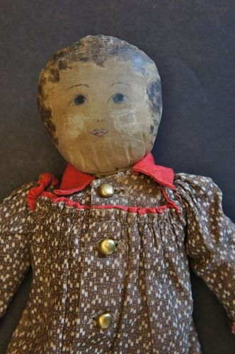 "A tiny adorable 11"" babyland rag doll, brown calico dress Circa 1890"