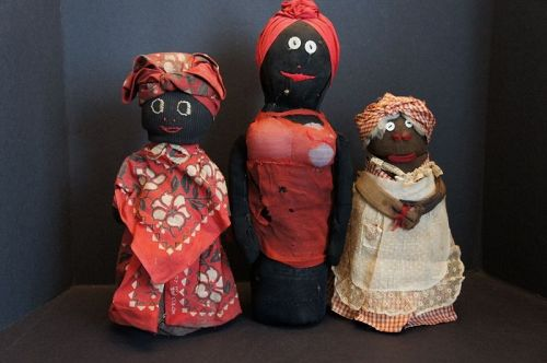 Three old black bottle doll doorstops 1900-1930