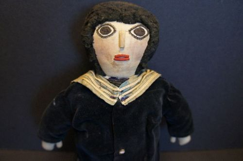 All original boy doll with sewn on blue velvet suit, terrific face 16""