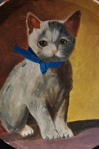 Painting of a cat kitten with a blue bow and the sweetest look 19th C.