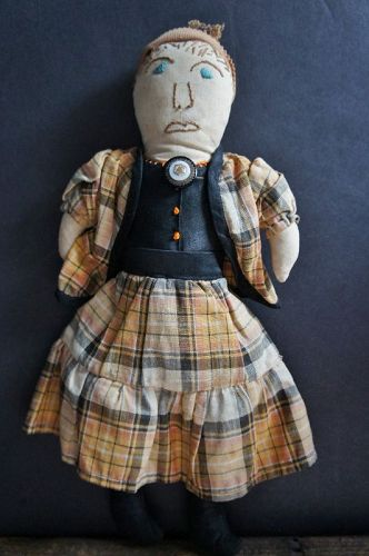 "Tooty is 11"" tall with an embroidered face and sewn on clothes C.1930"