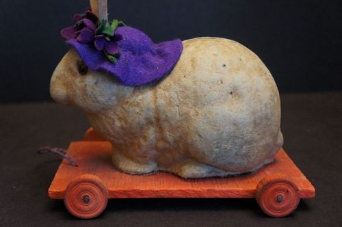 Pull toy rabbit in a purple hat