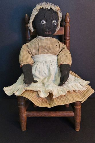 "Very nice little 13"" stockinette black doll great face great clothes"