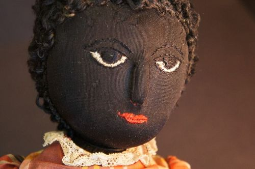 Near mint, packed away for most of her life, black cloth doll C.1890