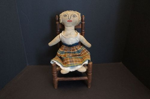 A strong statement for a little girl, antique cloth doll