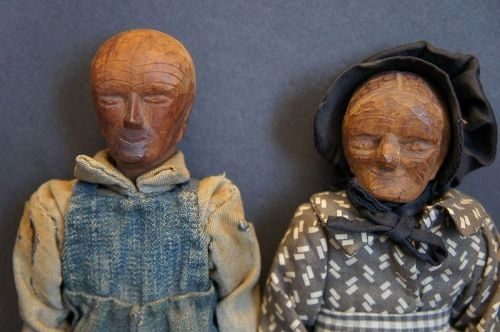 Carved wooden Tennessee mountain folk with handsewn clothes